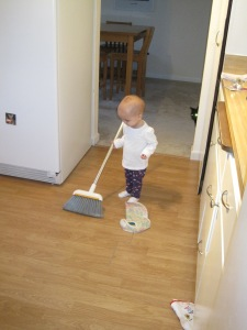 Helping Mommy sweep while Sid checks to see if the kitchen is clear.
