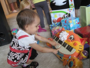 Making 'Meowsic' on her gift from Mom & Dad