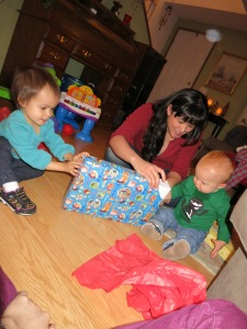 Sonja helps her cousin J.J. , one, open his birthday gifts