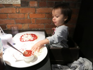 Making one of her favorite foods at Trackside Pizza