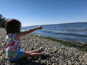 Sonja at Seahurst Park in Burien, chucking rocks.