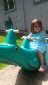 Sonja in her Elsa dress. Riding a crocodile.