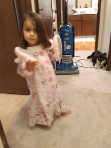 Sonja in PJs, photobombed by the dog, the vacuum and me.